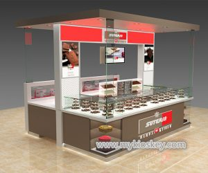 Sleek chocolate bread display kiosk with top decoration